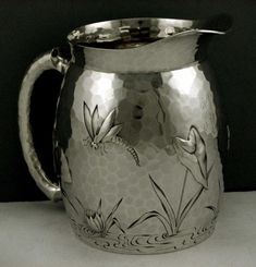 Dominick & Haff Japanesque style hammered sterling silver water pitcher, with waterlily and dragonfly motifs - New York, c1881 (supershrink)