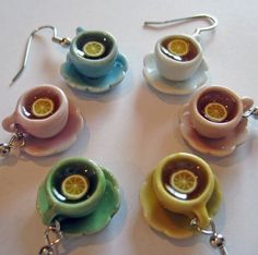 """My latest obsession! These spectacular little teacup earrings are so finely detailed and adorable. From Etsy, the shop is called """"Artwonders"""" and the artisan's name is Jody. She's extremely nice and has the most unique, cute, quirky, delicious little items! I'm a huge tea-lover, so I had to buy a pair of these for myself and my mom <3"""