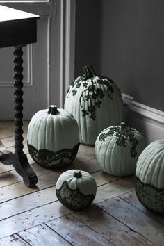 Give your pumpkins a ghastly look by dressing them in lace — which eerily mimics a spiderweb in an unexpected way. Click through for tutorial and more Halloween pumpkin decorating and design ideas.