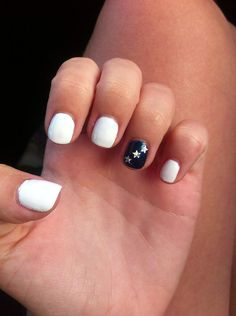 For an understated look, go full white with just one patriotic accent nail. Source: Twitter user samanthatryon