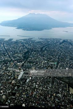 In this aerial image, Kagoshima City and Mount Sakurajima are seen on August 15, 2015 in Kagoshima, Japan. Residents of parts of Kagoshima city were warned to prepare to evacuate as the Japan Meteorological Agency said a major eruption of volcanic Mount Sakurajima could be imminent.