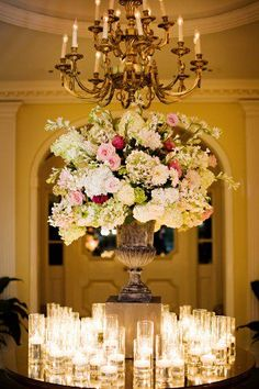 Beautiful lush large floral centerpiece + candles, candles, candles = GORGEOUS!