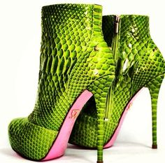 Green reptile boots with pink bottoms
