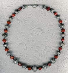 Well Suited  OOAK Grey Picture Jasper Red River by ChicStatements  Do you have a red or grey suit? Then this is your perfect accessory. It's interesting, but not overwhelming. A feminine statement. The graduated