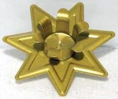 """Seven Pointed Star holder. Simple and affordable, this inexpensive seven-pointed star shaped candle holder is intended to fit 6"""""""" candles, but can be adjusted to fit larger tapers as well as chime candles."""