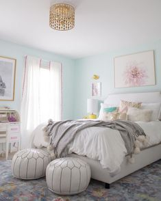 """""""Lily really wanted mint blue walls, so we custom mixed the perfect mint color for the walls, and paired it with lots of airy white for a really dreamy look. That gold pendant light is the perfect finishing touch and adds a bit of grown up glam, while the yummy velvet headboard is a sweet spot for reading and dreaming."""" -@laybabylay and @laurenlefevre {Link in profile to shop the sale} #designduos #jossandmainmakeover"""