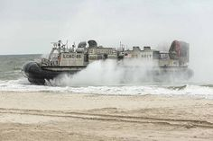 USTKA, Poland (June 14, 2017) A landing craft, air cushion lands on the beach in Ustka, Poland, during an amphibious assault landing demonstration as part of exercise BALTOPS 2017. The premier annual maritime-focused exercise is conducted in the Baltic region and is one of the largest exercises in Northern Europe.  (U.S. Navy photo by Chief Mass Communication Specialist America A. Henry/Released)