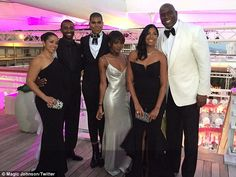 Family affair: Cookie, 57, was blown away to find her husband had flown in a hundred of their closest friends and family to mark their marriage milestone includingchildren Rich Kids Of Beverly Hills star EJ, his sister Elisa and Magic's oldest Andre (far left with wife Lisa Meyers)