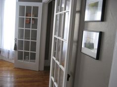 french doors for the bedrooms - with gray walls in there - but a white floor. some pink accents on jj's side- pink window seat?  we want a slightly paler, less brown gray