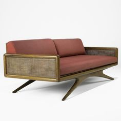 Vladimir Kagan; Walnut, Cane and Canvas Sofa for Kagan-Dreyfuss Inc., 1950s.