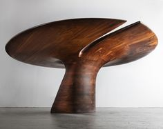 Stack laminated dining table in walnut, designed and made by Wendell Castle