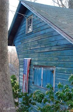 Love the American flag here.........this is a GREAT barn photo!! Not your typical color or straight on photo shot. LOVE this!!!