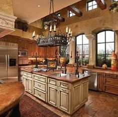Tuscan kitchen design immediately conjures images of Italy and sunlight and warmth. In fact these kinds of images are just what you need to think of when coming up with the perfect Tuscan kitchen design. Tuscany a region in north… Continue Reading → Tuscan Kitchen Design, Design Your Kitchen, Tuscan Kitchen Colors, Rustic Kitchen Island, Rustic Kitchen Decor, Kitchen Islands, Rustic Table, Wooden Tables, Kitchen Themes
