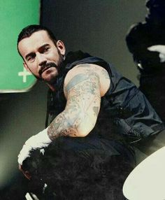 Punk #WWE - For some reason his outfit reminds me of The Shield :/