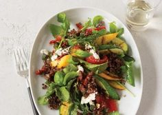 Make this your go-to salad for summer entertaining. Use red quinoa to play off the colors of the zucchini and bell peppers. The vegetables can be roasted under the broiler if you don't have an outdoor grill.
