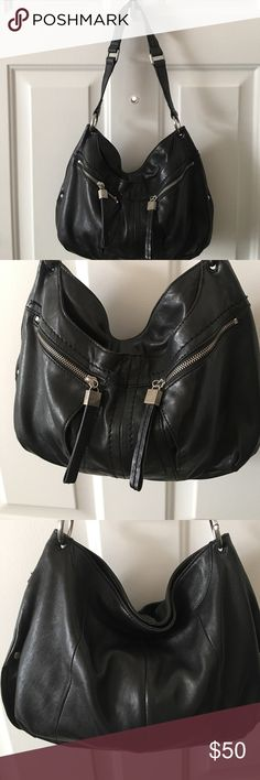 "Black leather hobo Two exterior zip pockets with one exterior slip pocket. Two interior slip pockets with one interior zip pocket. Snap closure. Measurements: 13x11x3"". Strap drop 12"" Perlina Bags Hobos"