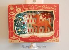 Reuse vintage ornament boxes by turning them into a christmas shadow box