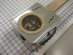 A link to this was posted in the comments to yesterday's cigar box guitar post, but I thought it was cool enough to get its own item. Be sure to check out