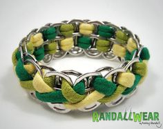 This is such a cute, comfy, stretchy pop tab bracelet. Its made from upcycled t-shirts and soda pop pull tabs. There is absolutely no new material in