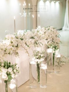 Brides Table with white roses, white orchids and champagne table cloths. Candlelight and flowing flower runners, flower draping. Bride, wedding flowers, Royal wedding, Lux wedding, Luxe Wedding, classic wedding. Photographer Rensche Mari