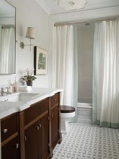 """2 shower curtains to """"frame"""" the tub."""