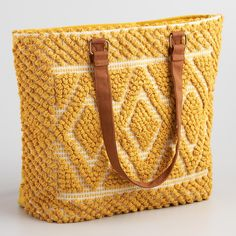 Made of yellow woven fabric with geometric design this eclectic bag is amply sized and great for carrying all of your essentials.