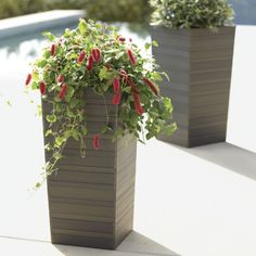 Clean taper shapes in graduated slats have the look of wood with the easy-care of plastic, making them a natural for outdoor use. Grey wash finish adds to the organic look.<br /><br /><NEWTAG/><ul><li>Plastic</li><li>No drainage opening</li><li>Made in China</li></ul>