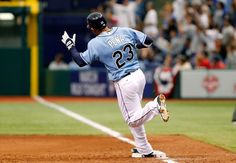Carlos rounds the bases on his solo home run against the Yankees 04/08/12