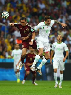 Carl Medjani Photos - Aleksandr Kerzhakov of Russia and Carl Medjani of Algeria go up for a header during the 2014 FIFA World Cup Brazil Group H match between Algeria and Russia at Arena da Baixada on June 26, 2014 in Curitiba, Brazil. - Algeria v Russia: Group H