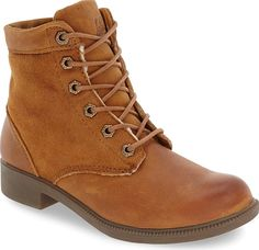 kodiak Women's Shoes in Caramel Leather Color. A waterproof finish and warm genuine shearling lining enhance the comfort and utility of this sturdy yet chic leather boot. A durable rubber outsole with chevron treads provides sure-footed traction even in slippery conditions.