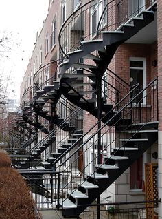 Gorgeous spiral stairs in Montreal, Canada. Must visit one day! Montreal Architecture, Stairs Architecture, Amazing Architecture, Iron Staircase, Staircase Design, Spiral Staircases, Montreal Ville, Montreal Quebec, Montreal Canada