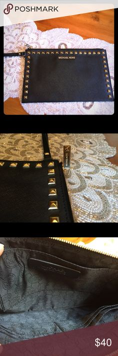 NWOT Michael Kors black/gold studded clutch Brand new Michael Kors black and gold studded zipper clutch. Inside features card slots and side pocket. Michael Kors Bags Clutches & Wristlets