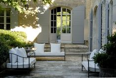 stunning - rock or slurry stone or stucco, love the huge shutters and steps