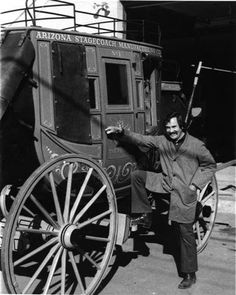 My husband is obsessed with stagecoaches like that! I don't know what it is. Maybe he loves the huge wheels, or maybe he just loves seeing how the world used to be. If he saw something like this, he would definitely pose and take a picture, just like the guy in this post!