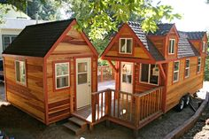 Tiny house with additional companion studio with sleeping loft above and joined by shared deck.