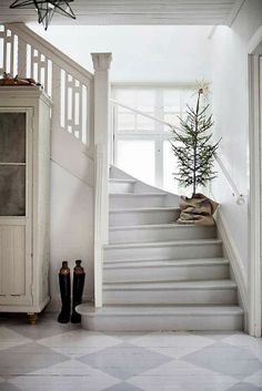 I do like the tree on the stairs. Very simple.