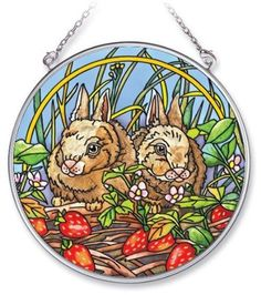 Amia 5477 Bunny Design Hand-Painted Glass Suncatcher with Chain, 4-1/2-Inch Circle by Amia. $13.00. Handpainted glass. Includes chain. Comes boxed, makes for a great gift. Amia Glass is a top selling line of handpainted glass decor. Known for tying in rich colors and excellent designs, Amia has a full line of handpainted glass pieces to satisfy your decor needs. Items in the line range from suncatchers, window decor panels, vases, votives and much more.