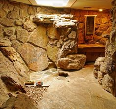 Years ago I saw photos of this really kewel stone cave bathroom with a waterfall shower.