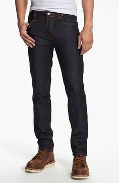Free shipping and returns on Nudie Jeans Nudie 'Grim Tim' Skinny Fit Jeans (Organic Dry Navy) at Nordstrom.com. Rich orange stitching on dark, dry raw denim offers a clean, classic appearance to slender jeans crafted from an organic cotton-blend with a substantially stiff and starchy texture that softens with time and wear. Those in the know suggest sizing down and washing very infrequently. That will allow the denim to conform to your shape and take on the personal wear lines and fading ...