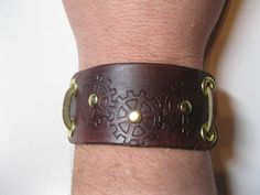Steampunk leather bracelet / cuff with stamped gears by Zolgar. My brother was wearing one of these this weekend and it looks awesome!