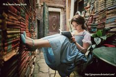Lost in my world of books - Belle by giusynuno.deviantart.com