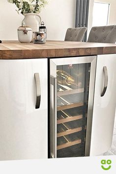 A wine fridge can solve all your wine storage issues and a wine cooler finishes off this kitchen fro Kitchen Room Design, Kitchen Interior, Kitchen Wine Decor, Condo Kitchen, Kitchen Pantry, Best Wine Coolers, Frat Coolers, Built In Wine Cooler, Refrigerator Storage