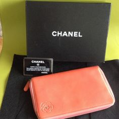 authentic Chanel Camellia wallet Beautiful Chanel Camellia wallet. 8 card slots. Pre loved, nut in good condition. Wears on the corner. More pics are available upon request. Purchased in Chanel boutique in Miami. Comes with original box and cloth(provided at the boutique in stead of dust bag). 480pp. CHANEL Bags