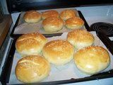 Here a good Hamburger bun recipe that is very easy to make.Ingredients:1 cup milk1 cup water2 Tblsp. Butter1 Tblsp. white sugar1 1/2 tsp. salt5 1/2 cups all-purpose flour2 1/2 tsp yeast (1 envelope)1 egg yolk1 Tblsp. water1) Combine the milk 1 cup of water, butter, sugar and salt in a saucepan. Bring to a boil then remove it from the heat and let stand until it is luke warm (if the mix is too hot it will kill the yeast).2) Stir together the flour and yeast in a large bow