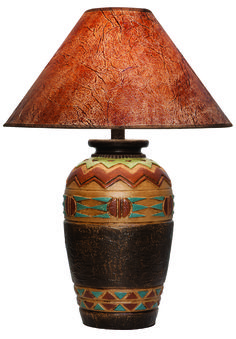 A southwest table lamp will look fabulous in your home next to poncho throw on your couch and a rustic wall hanging.