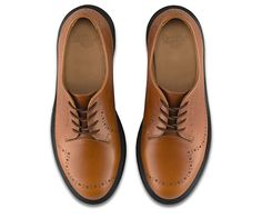 These brogues take the essence of the shoe's traditional form and give it a Dr. Martens spin. Light etchings dance around the upper, over smooth oak leather with a subtle, oily finish. With few seams and our signature air cushioned sole, these are an instant classic.They're part of the Refined Kensington collection.