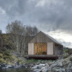 Naust paa Aure by TYIN tegnestue Architects. A lot of the materials were reused, either as shuttering for the concrete walls and footings or as internal panelling. Timber Panelling, Dezeen, Interior Walls, House In The Woods, Interior Architecture, Facade, Sweet Home, Construction, House Styles