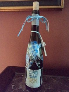 Something and More Crafts and Gifts - Hand Painted Glassware Lighted Wine Bottles, $20.00 (http://www.somethingandmore.com/hand-painted-glassware-lighted-wine-bottles/)