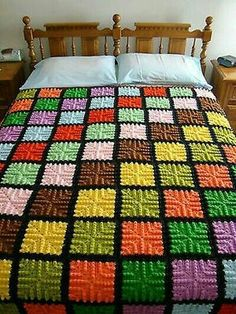 Up for bid is a VINTAGE Handmade Crocheted Throw Bedspread Mulit-colored Blocks 72 x 74 .This is displayed on a queen size bed - the 74 is across the bed and hangs to the dust ruffle - the 72 is leThis is hand crocheted each square is a different var Crochet Rug Patterns, Crochet Bedspread, Crochet Quilt, Granny Square Crochet Pattern, Crochet Squares, Tunisian Crochet, Crochet Blocks, Granny Squares, Crochet Motif