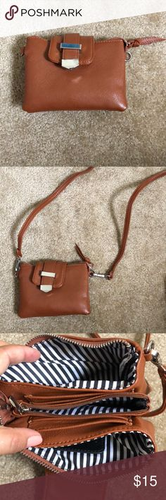 Small brown crossbody Cute little cross body bag, tons of pockets, removable strap. 10% of your purchase is donated to victims of sexual assault Bags Crossbody Bags